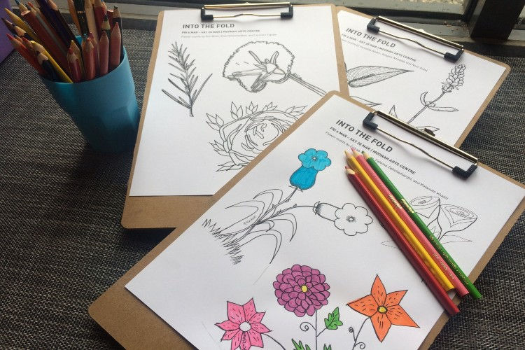 Pages with drawings of flowers and colour pencils.